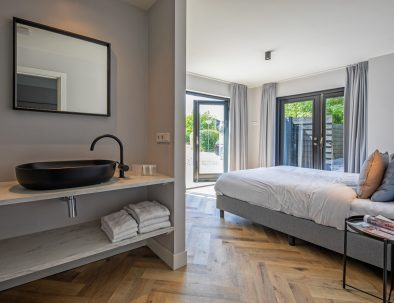 Master bedroom with a lot of privacy in vacation rental Texel